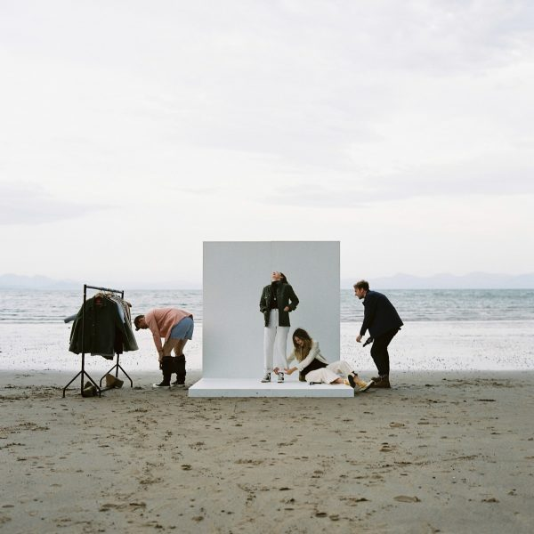 Paynter jackets photoshoot of models on photoshoot set, set up on a beach