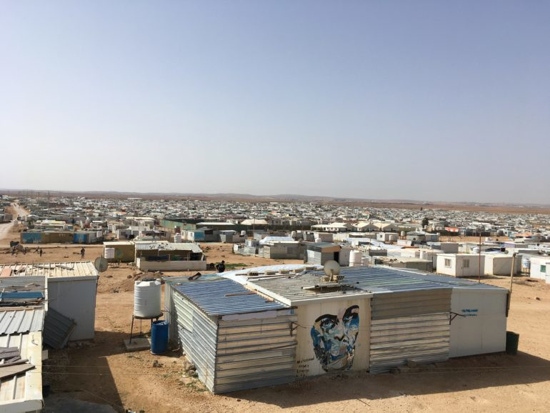 An image of Za'atari refugee camp with blue skies