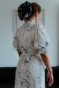 woman looking away from the camera wearing Birdsong dress