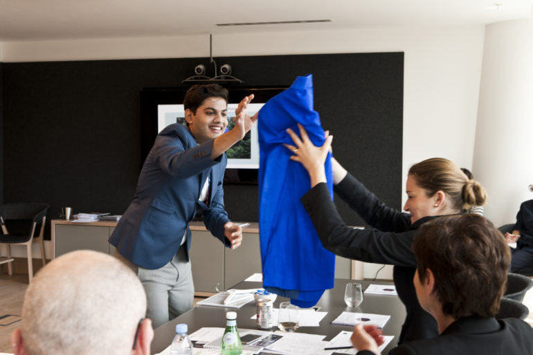 Agraj presenting his peace silk jacket to judges from Kering. photo credit: Ana Escobar