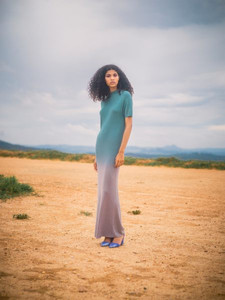 woman stood on sand in dress by Away to Mars
