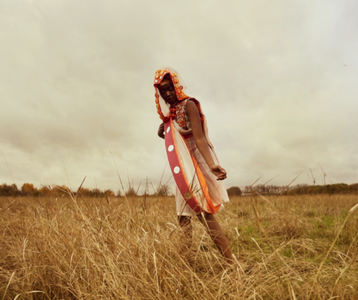 woman in a field wearing a design by Anustha Kishor