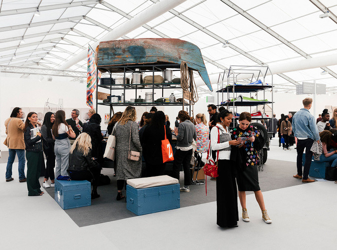 people surrounding a stall for Antarctica World Passport in a Frieze Art Fair