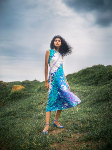 woman stood on grass in dress by Away to Mars