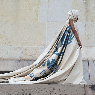A woman wearing a dress made out of tent