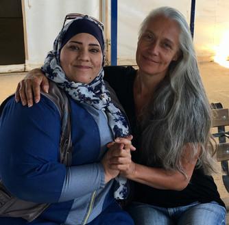 Helen with Ahlam, Women's community leader in Zaatari