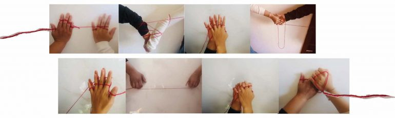 hands with string intertwined as part of research