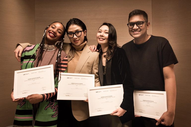 four winners stood holding their Kering Awards smiling