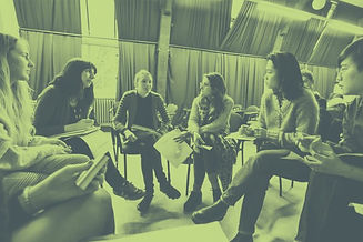 a group of students in a circle having a discussion