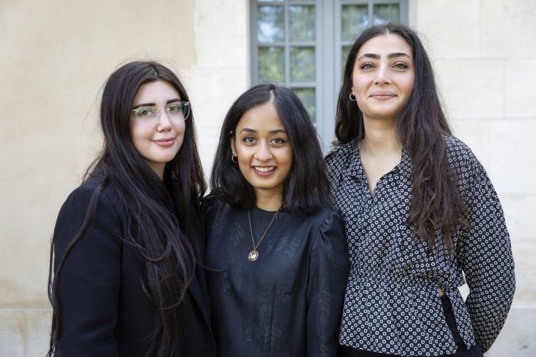 the three winners of the CU at Kering in Paris smiling