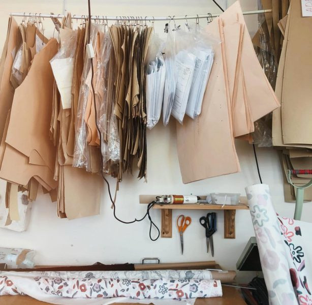 interiors of a fashion design studio with pattern pieces hanging