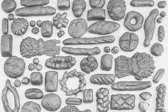 a piece from Lucy + Jorge Orta's forthcoming exhibition, featuring hundreds of loaves baked by local Peterborough residents and cast in aluminium