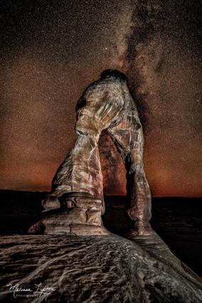 Milky Way through Delicate Arch - Melissa Lipton Photography