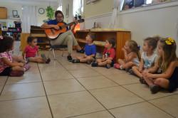 Ms. Sara playing Guitar