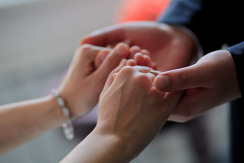 Couple-Holding-Hands-at-wedding.jpg