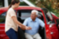 Photo of woman helping older adult out of car