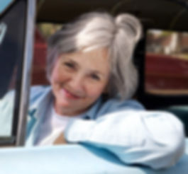 Photo of woman in driver seat of car