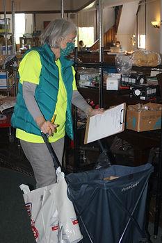 Food Pantry volunteer filling a customer order.