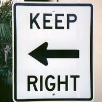 Sign points to left says keep right (Bad Translation)