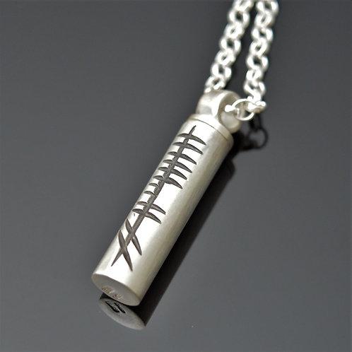 small handmade ogham keepsake pendant