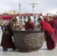 Monks relaxing in Barkhor Square, Tibet.