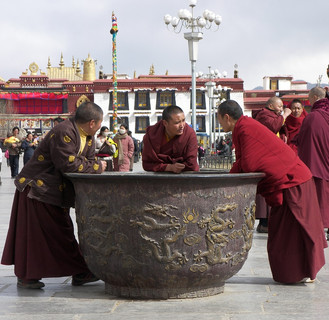 Monks relaxing in Barkhor Square, Tibet.