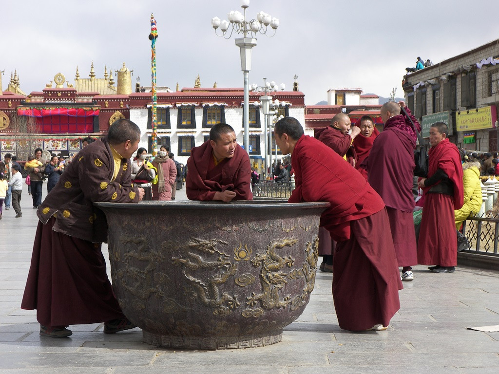 Monks relaxing in Barkhor Square