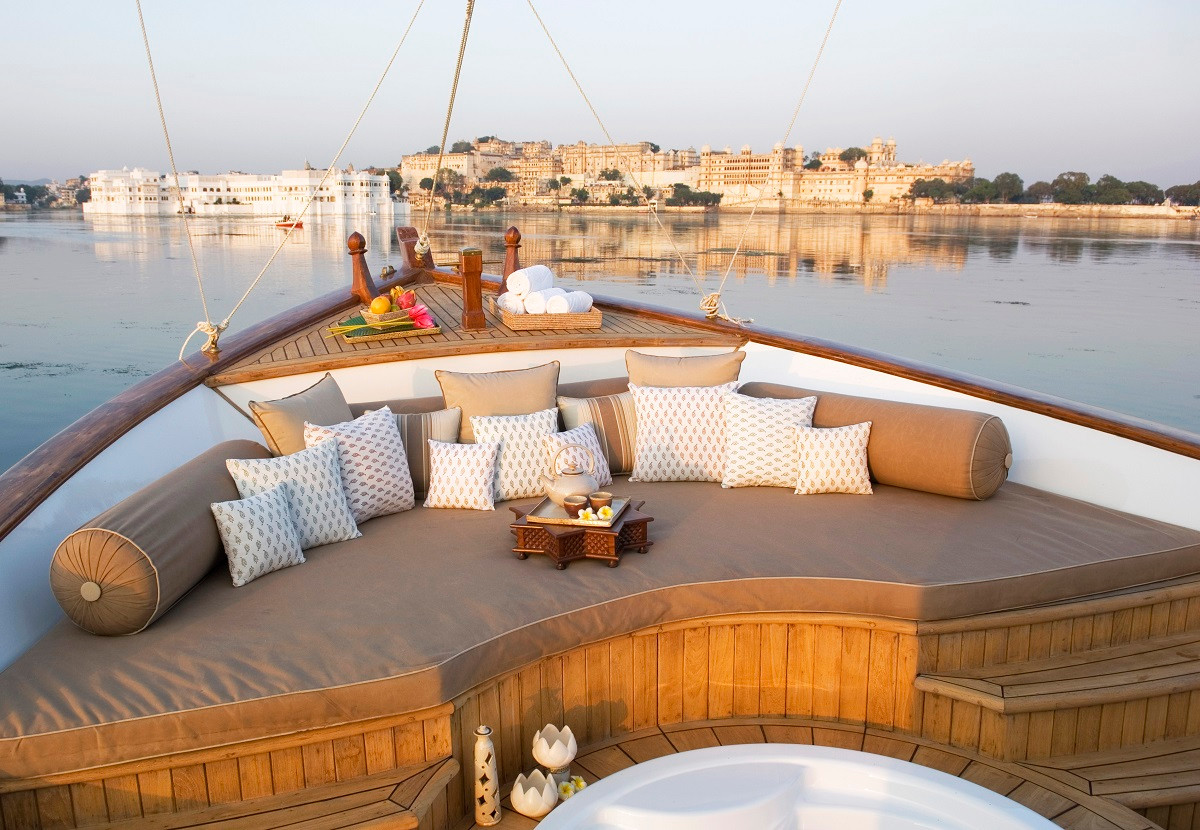 Enjoy a sunset boat ride on Lake Pichola with first hand views of the Lake Palace