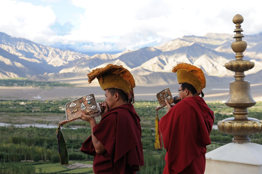 Monks blowing Conchs