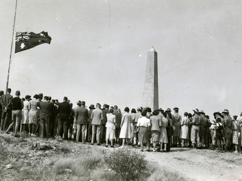 At the height of World War II, the Anzac Day events of 1945 attracted record numbers at ceremonies around the country, including this one on the top of ANZAC Hill in Alice Springs. A place of layered histories, the site was first known as Untyeyetwelye by Arrernte people, until the Reverend Harry Griffiths of the Australian Inland Mission suggested it would be a good place for a war memorial, which was built in 1934. The site has been the venue for local ANZAC Day ceremonies since. Last year the Aboriginal flag was flown on the hill for the first time.  28 April 2019  Image: Marjorie Andrew, PRG 1708/3/26, State Library of South Australia
