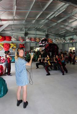 Caddie Brain recording the Chung Wah Lion Dance Troupe