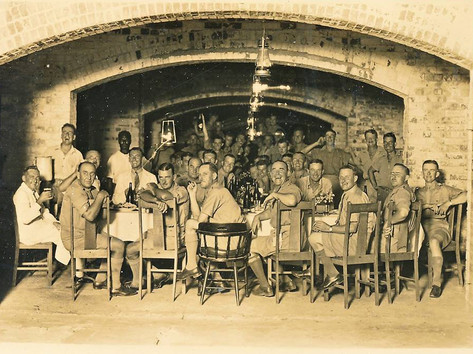 "Ahead of next week's 77th anniversary of the bombing of Darwin, this image has sparked lots of discussion on Facebook - was it in Darwin and what's the occasion? Turns out it's the Darwin Detachment holding a 'smoke social' in the vaults under the Mess Hall at Bullocky Point in 1934. In the decades after Vestey's Meatworks closed in 1920, the site became a military barracks for the detachments tasked with developing the Top End's defence infrastructure including the 6-inch guns at East Point and Larrakeyah Barracks. The party farewelled departing servicemen who had done their bit and were heading home. Despite the ""innovations in dress not widely favoured further south imposed by semi-tropical climate,"" the occasion was reported in the Northern Standard to have been ""a great success"".  17 February 2019  Image: Kerry Mark"