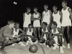 """The Bagot """"All Black"""" Basketball team. They formed in 1953, just five years after the newly established NT Basketball Association held its first competition in Darwin and quickly became """"all the rage"""", according to the papers at the time. Ahead of their first season, the Bagot team was reportedly """"wearing out balls in practice matches at the rate of about one every ten days"""". Their games held at a boxing stadium in Cavenagh Street drew big crowds, many of whom came to see the talents of defence Jack White (squatting third from the left), who was known for his speed and """"coolness under pressure"""". The team even funded equipment by repeat performances of a corroboree performed to the Queen and Duke on their 1954 tour. An exhibition celebrating 70 years of basketball is now on at Northern Territory Library until 26 May, developed with basketball legend Maisie Austin.  14 April 2019  Image: Harney McCaffery Collection, Northern Territory Library"""