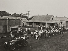 """Tomorrow marks a century since Darwin's infamous rebellion, which climaxed with angry residents marching through the streets and then burning an effigy of the the Administrator Dr John Gilruth. A range of factors had caused tempers to boil over. The NT had been handed back to the Commonwealth in 1911, leaving Territorians unrepresented at the highest level, plus there were ongoing industrial disputes and, perhaps the clincher, Darwin's hotels had been nationalised which led to a significant jump in the price of beer. So after stop-work meetings on the morning of 17 December 1918, it was on. About 1,000 men walked to Government House with placards saying demanding """"no taxation without representation"""" carrying an effigy of Gilruth tied to a stake. After weeks of what was essentially imprisonment in Government House, Gilruth left town.  16 December 2018  Image: Rodgers Collection, Northern Territory Library"""