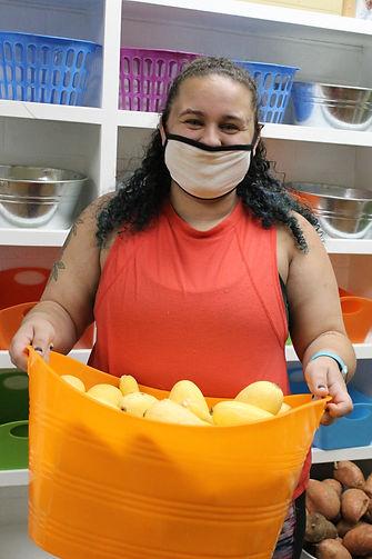 Alyssa holding fruit part 2.JPG