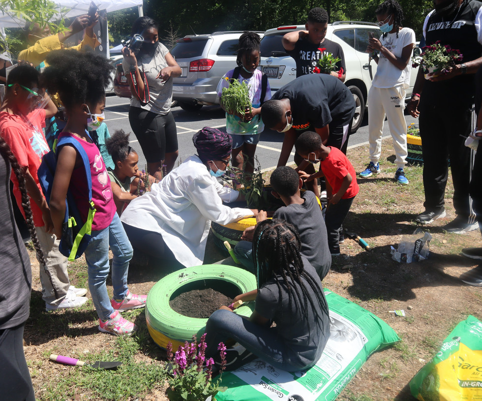Champion Gardeners Youth Entrepreneurs Inc. planting Butterfly Gardens with the community.