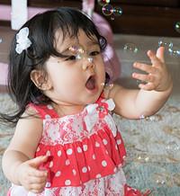Sofia Chasing Bubbles.jpg