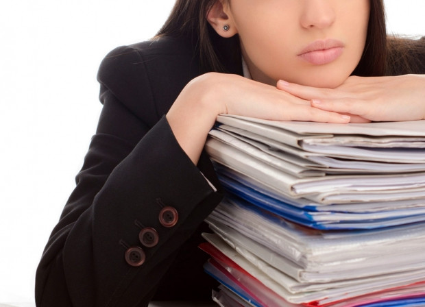 Woman-With-Stack-Of-Papers-Overwhelmed.jpg