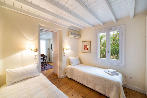 The Sun's second bedroom with 2 single beds