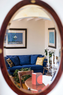 Mirror view of the Sun's living room and dining table