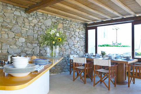 Outdoors kitchen and chef bench for food and cocktails with ingredients from our garden