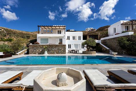 The Galaxy Mykonos' Houses, pool, marble fountain and loungers