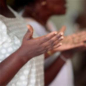 blaxk women praying.jpg