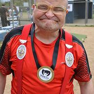 Smiling disabled man wearing Shangri-La medal
