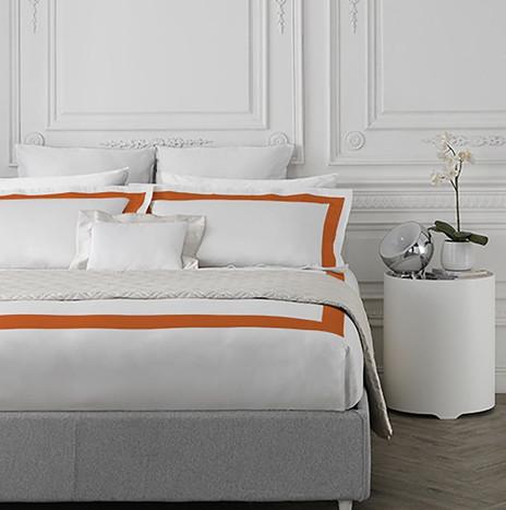 Parure copripiumino con bordo applicato nuance orange.jpg