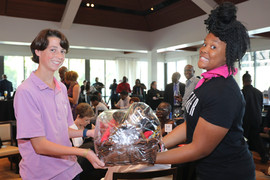 Volunteer handing over a prize to a raff