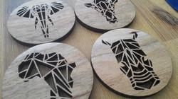 Geometric animal coasters cut from Blackwood