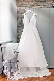 Wedding Gown on Hanger.jpg