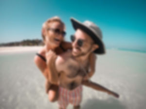 couple planning on beach in water.jpeg