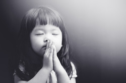 Little girl praying in the night
